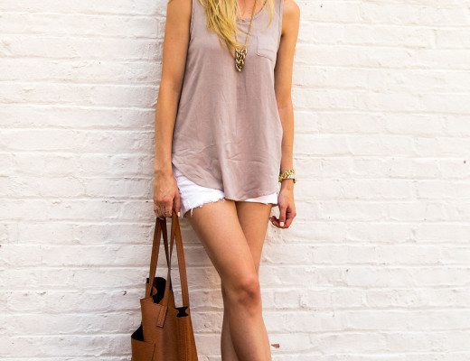 white ripped shorts, tan tank top and tote bag
