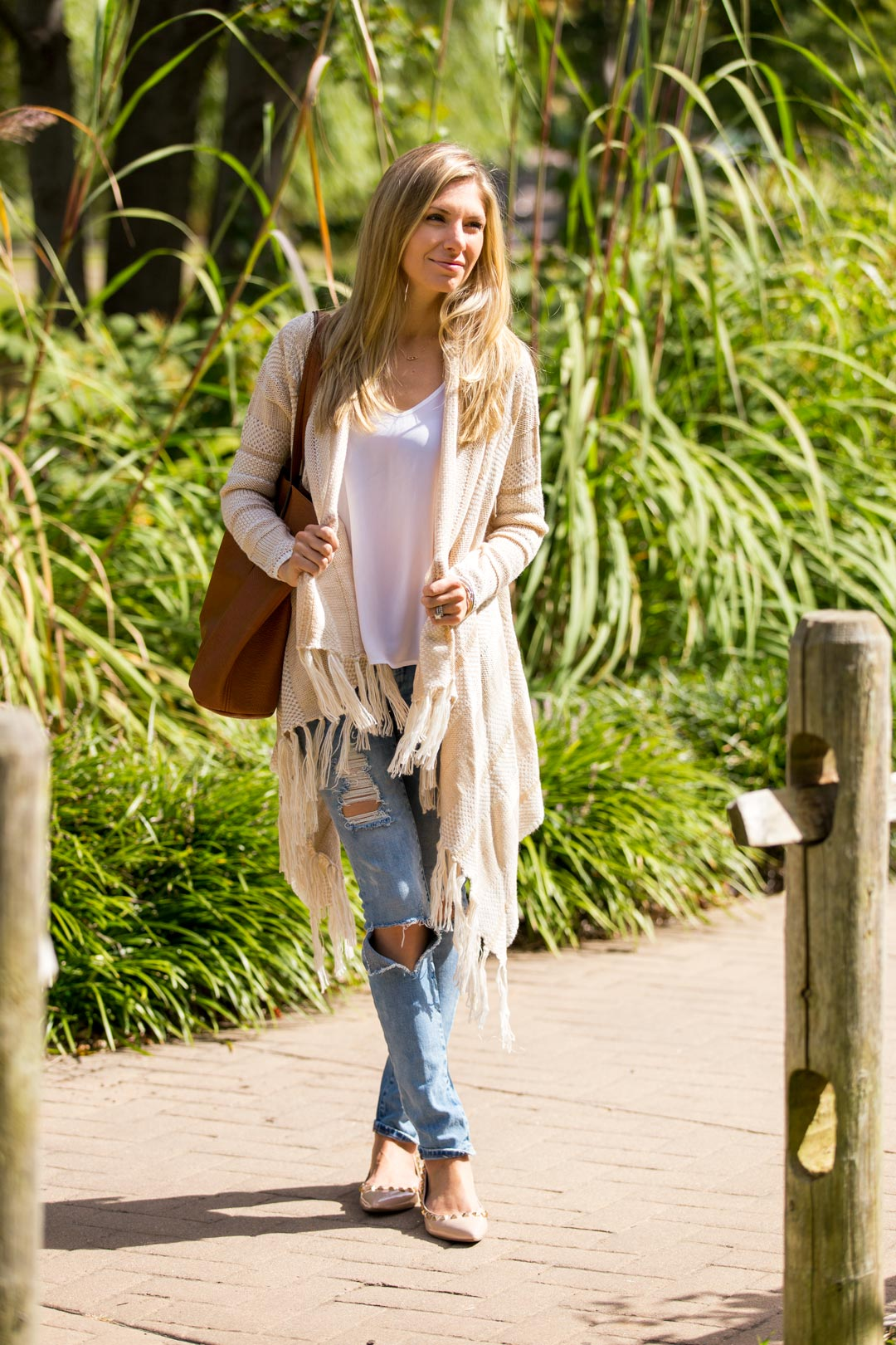 blank denim ripped jeans, studded flats and topshop tank top