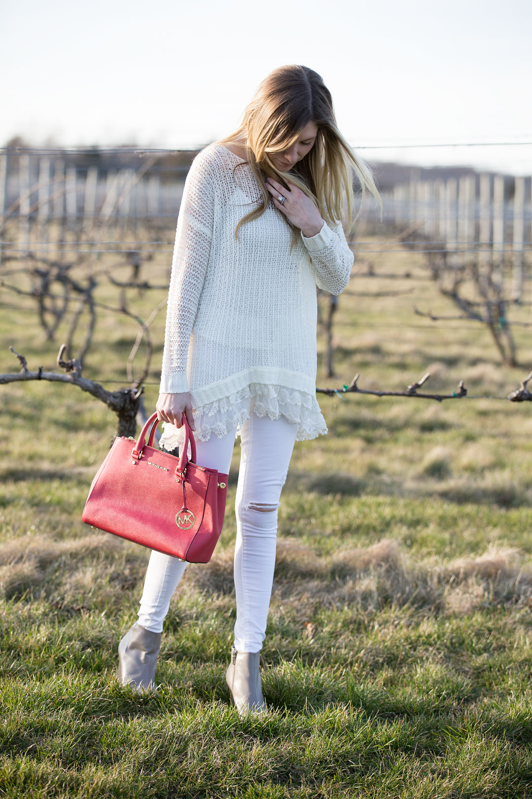 ruffle sweater and pink accent purse