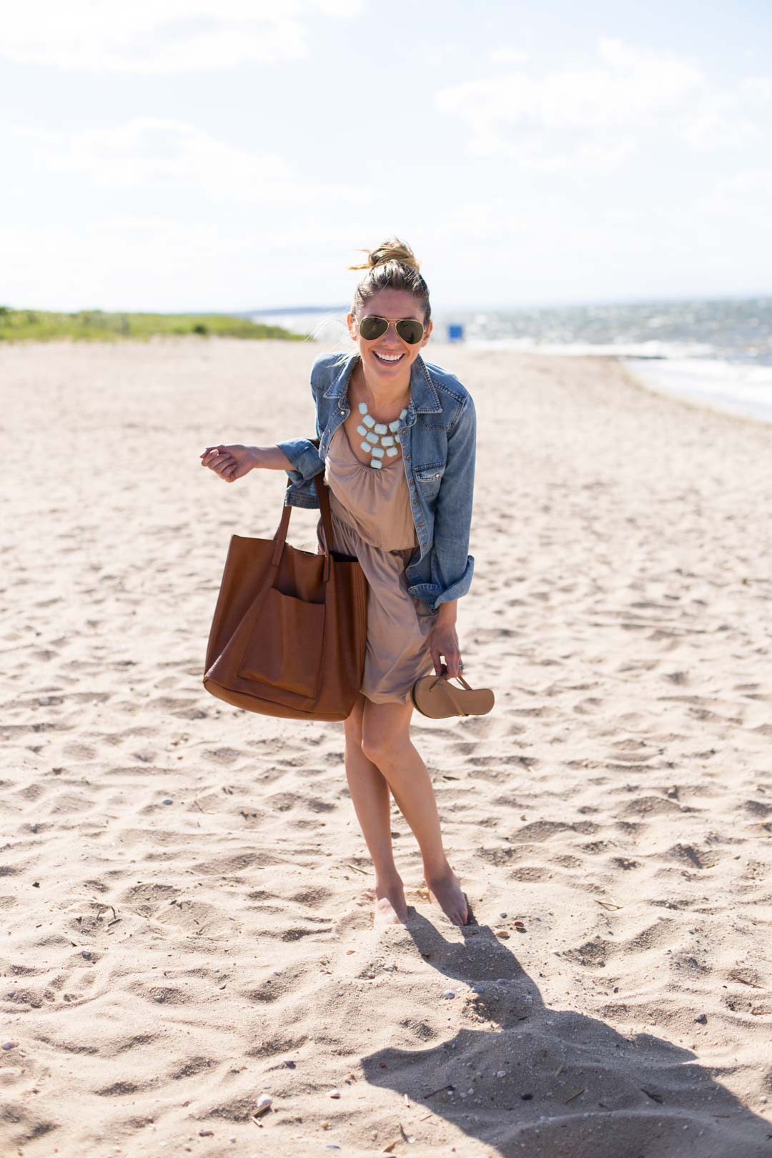 top knot, lauren conrad flip flops and statement necklace