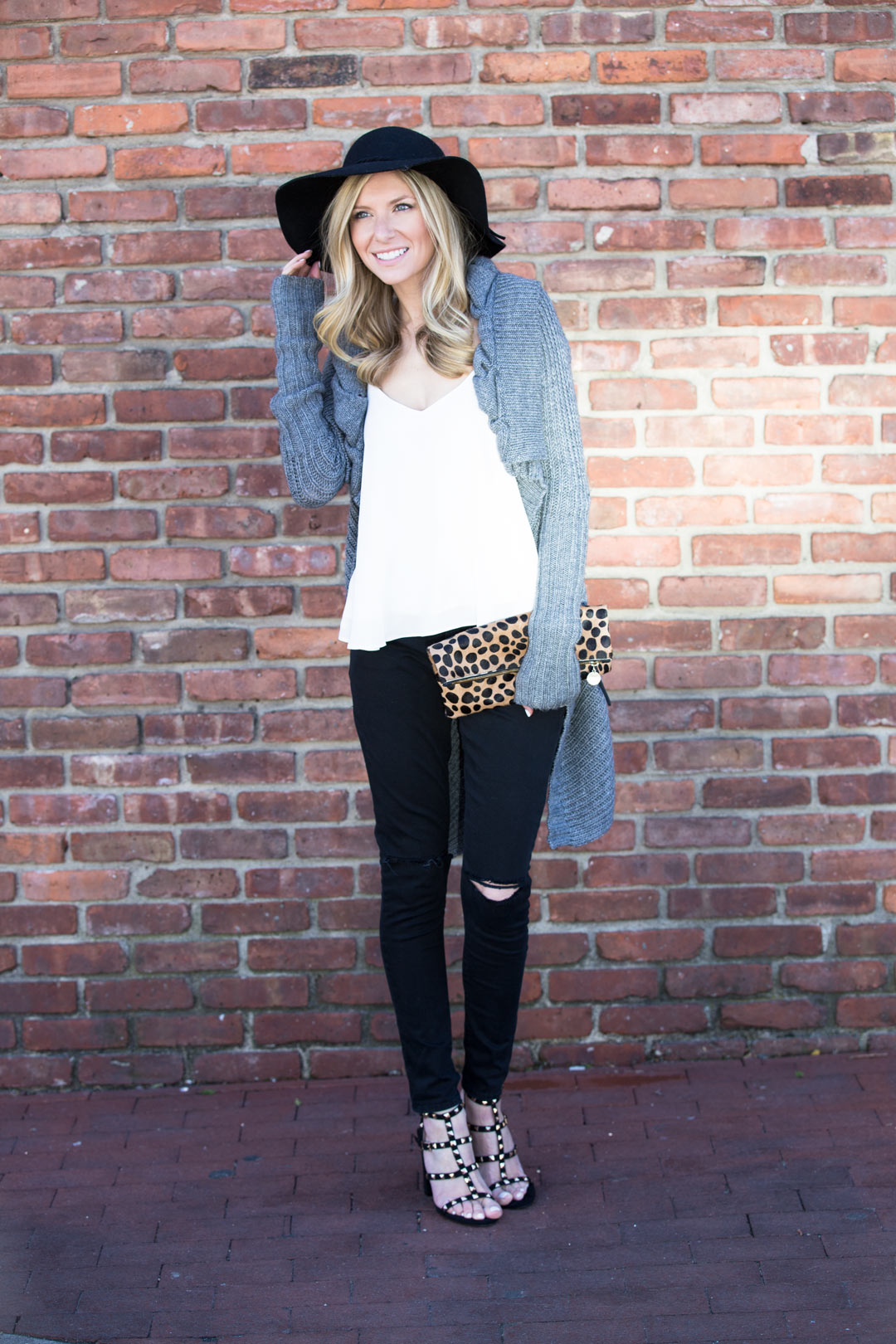 oversized gray sweater and ripped black jeans