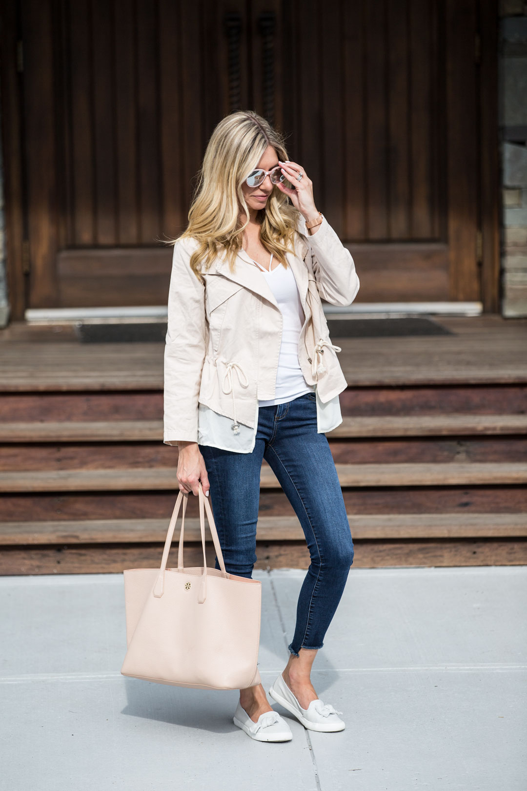 blush tory burch bag and blush cropped trench coat