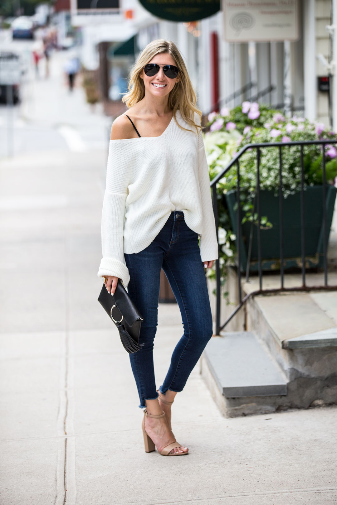 dark cropped denim and white sweater