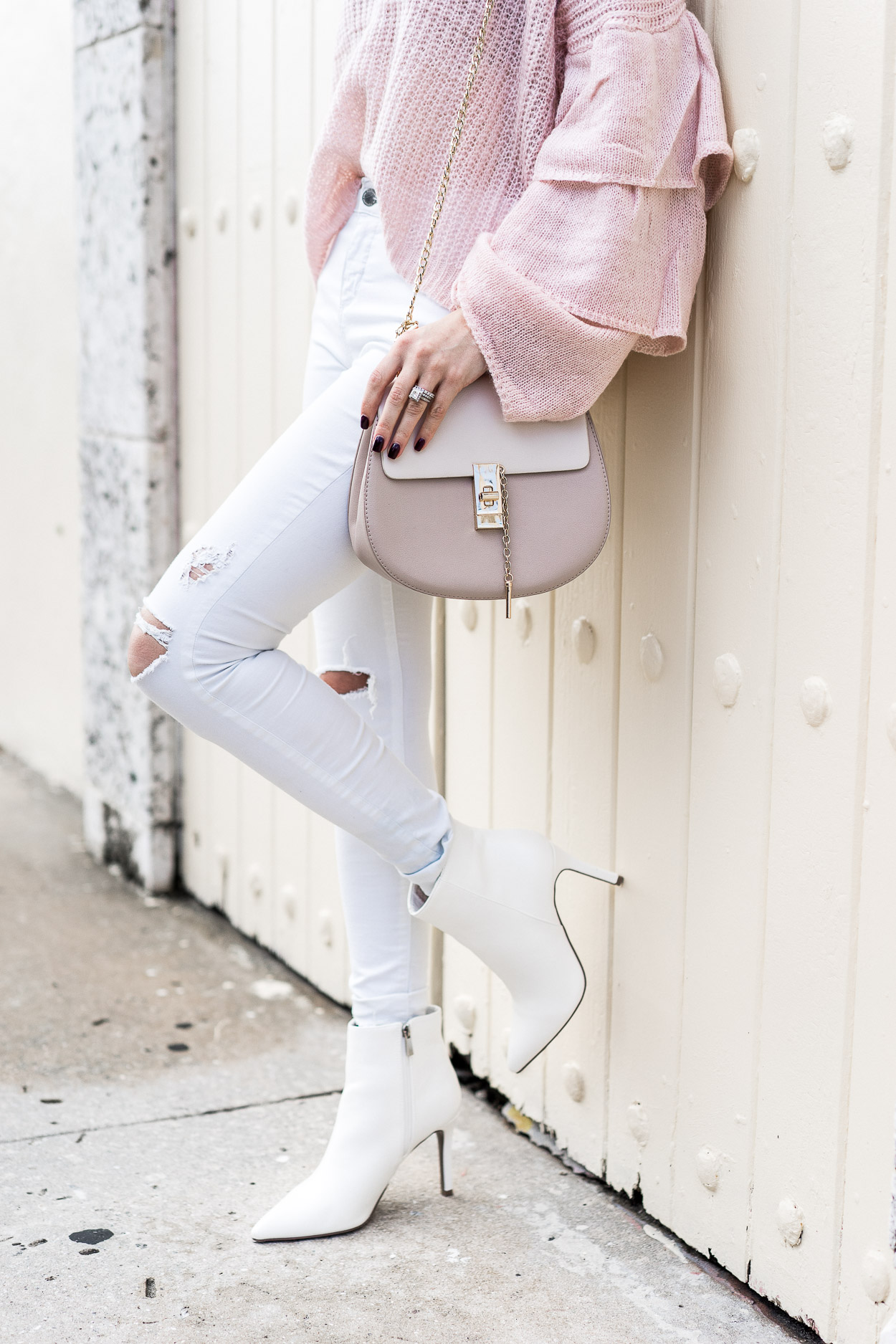 white stiletto booties and neutral gold bag