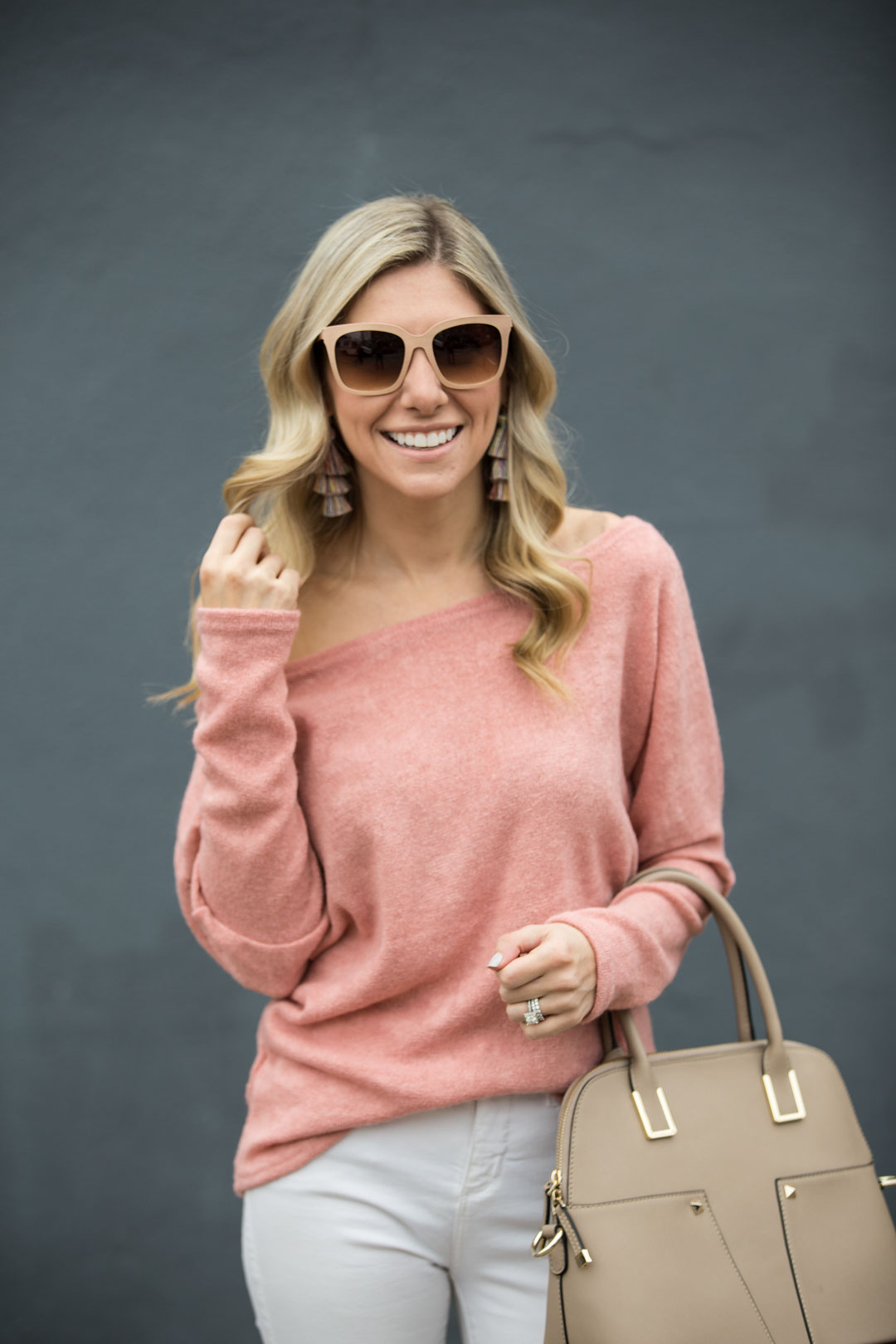 Coral Off-the-Shoulder Sweater and White Jeans