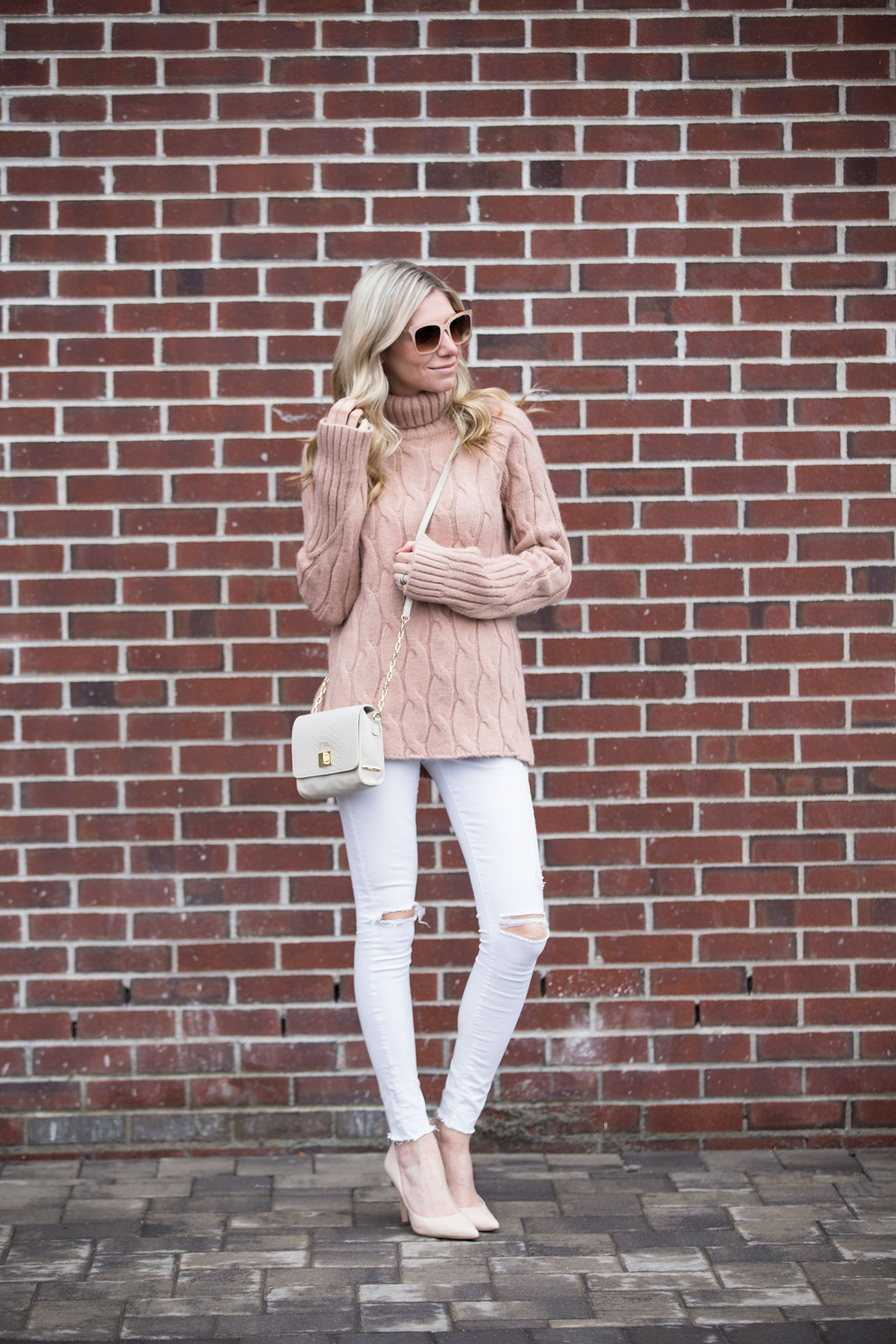tan cableknit sweater and nude heels