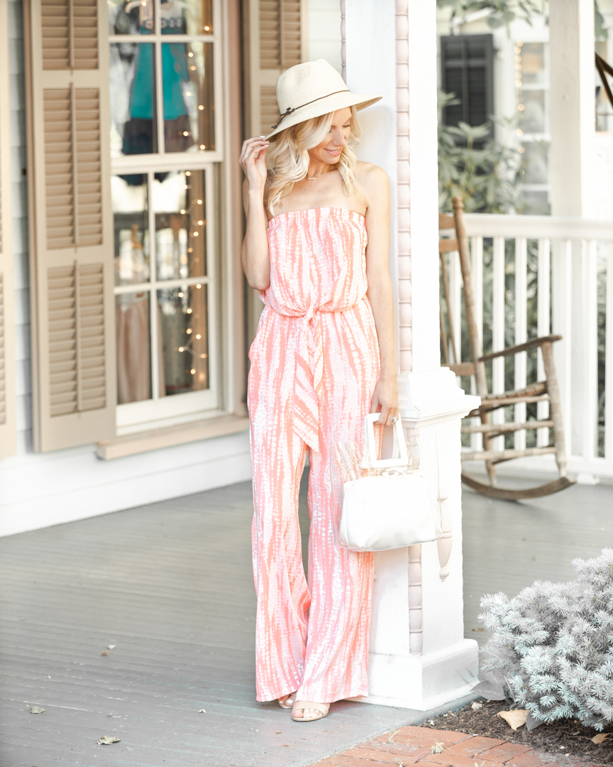 coral jumpsuit and transparent tote