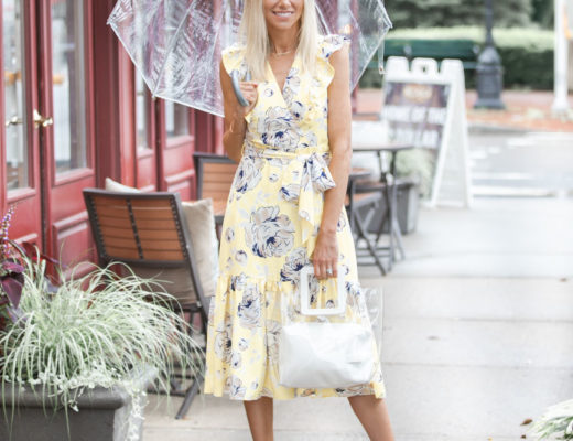 yellow wrap dress with white accessories