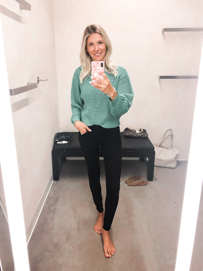 turquoise sweater and black jeans