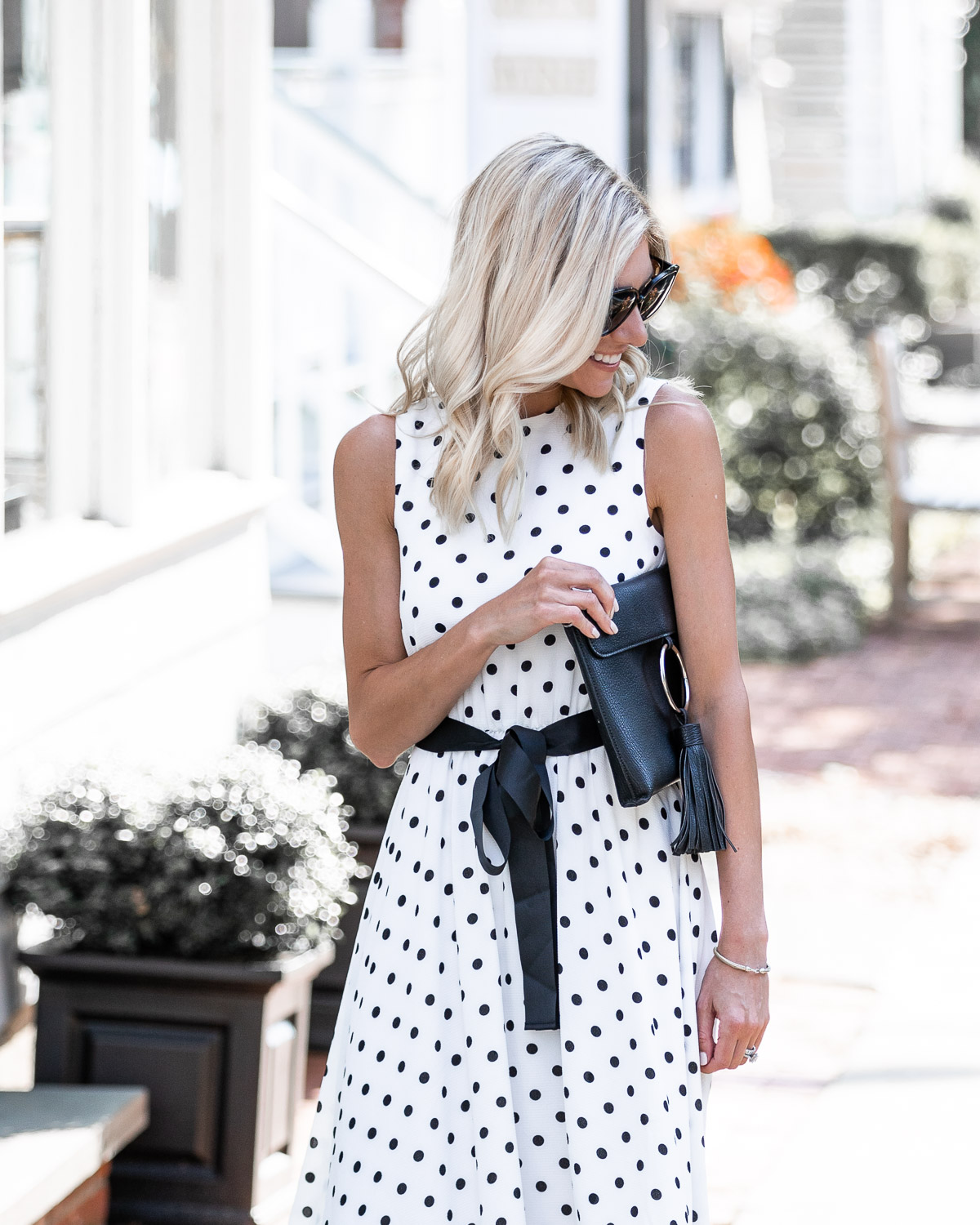 black and white polka dot dress with satin sash The Glamorous Gal