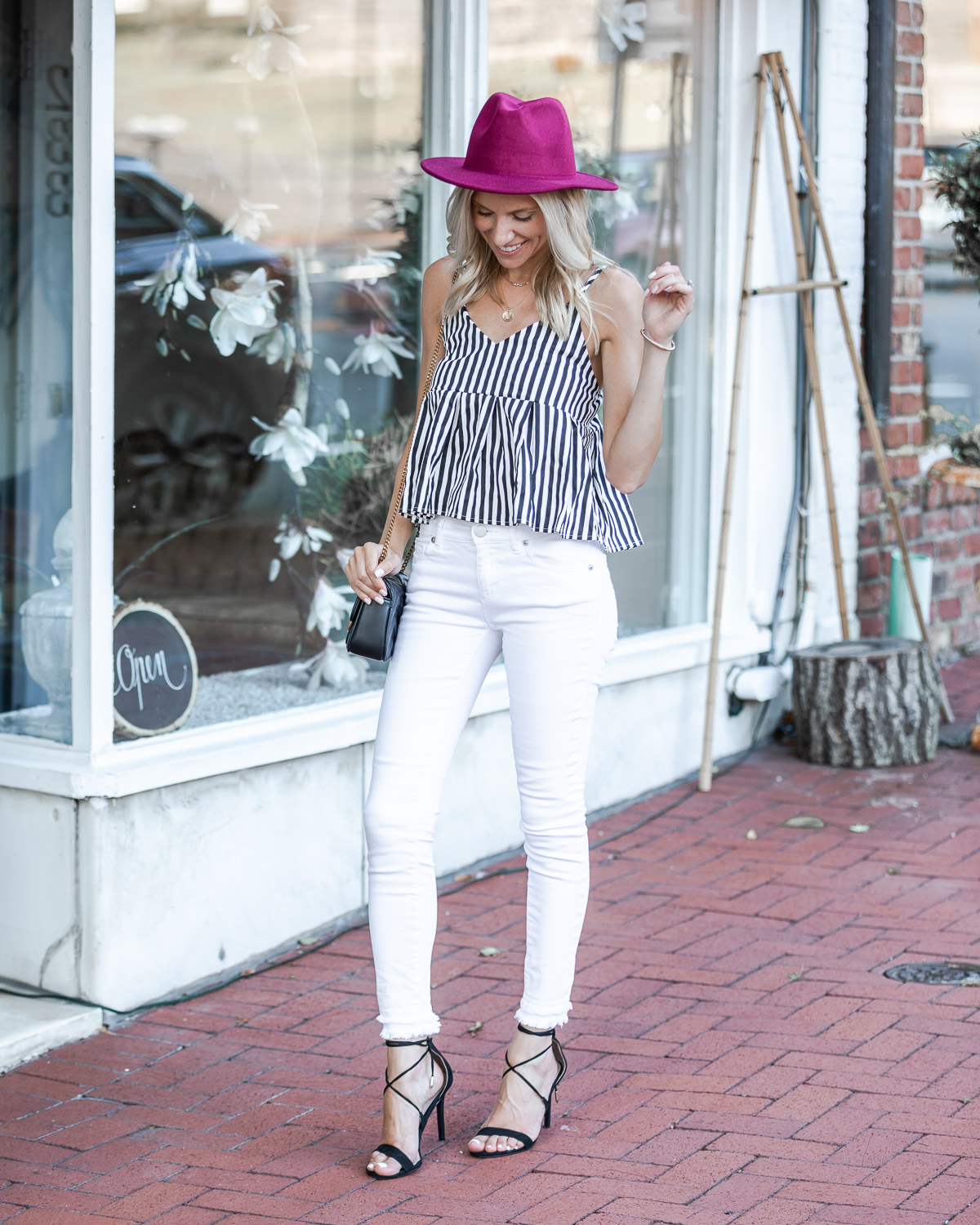 maroon hat and striped tank top for summer The Glamorous Gal