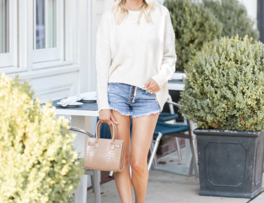 slouchy sweater and frayed denim shorts The Glamorous Gal