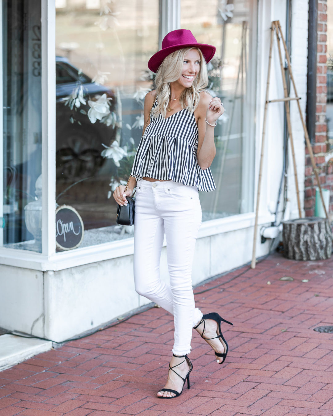striped peplum tank top and white jeans The Glamorous Gal