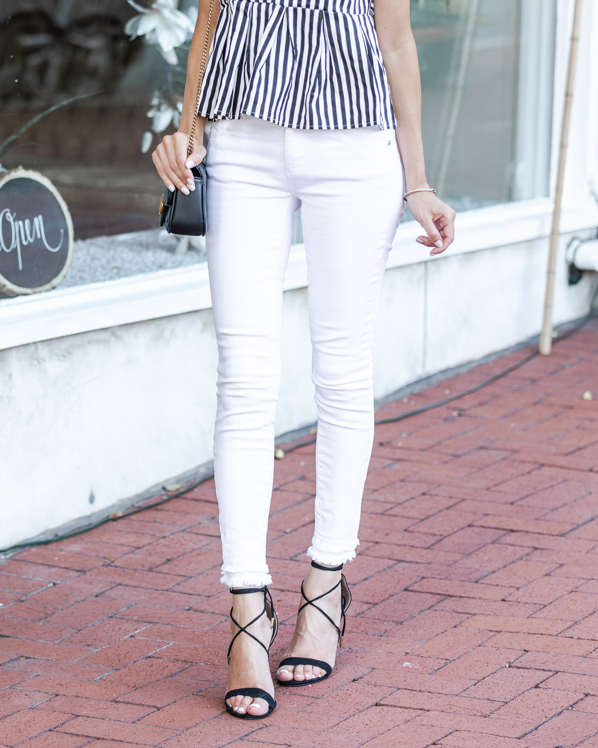 white skinny jeans and black stiletto heels The Glamorous Gal