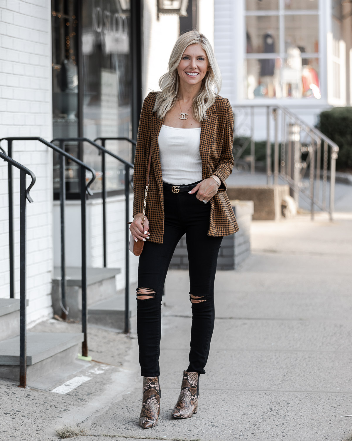 simple black ripped jeans and houndstooth blazer The Glamorous Gal