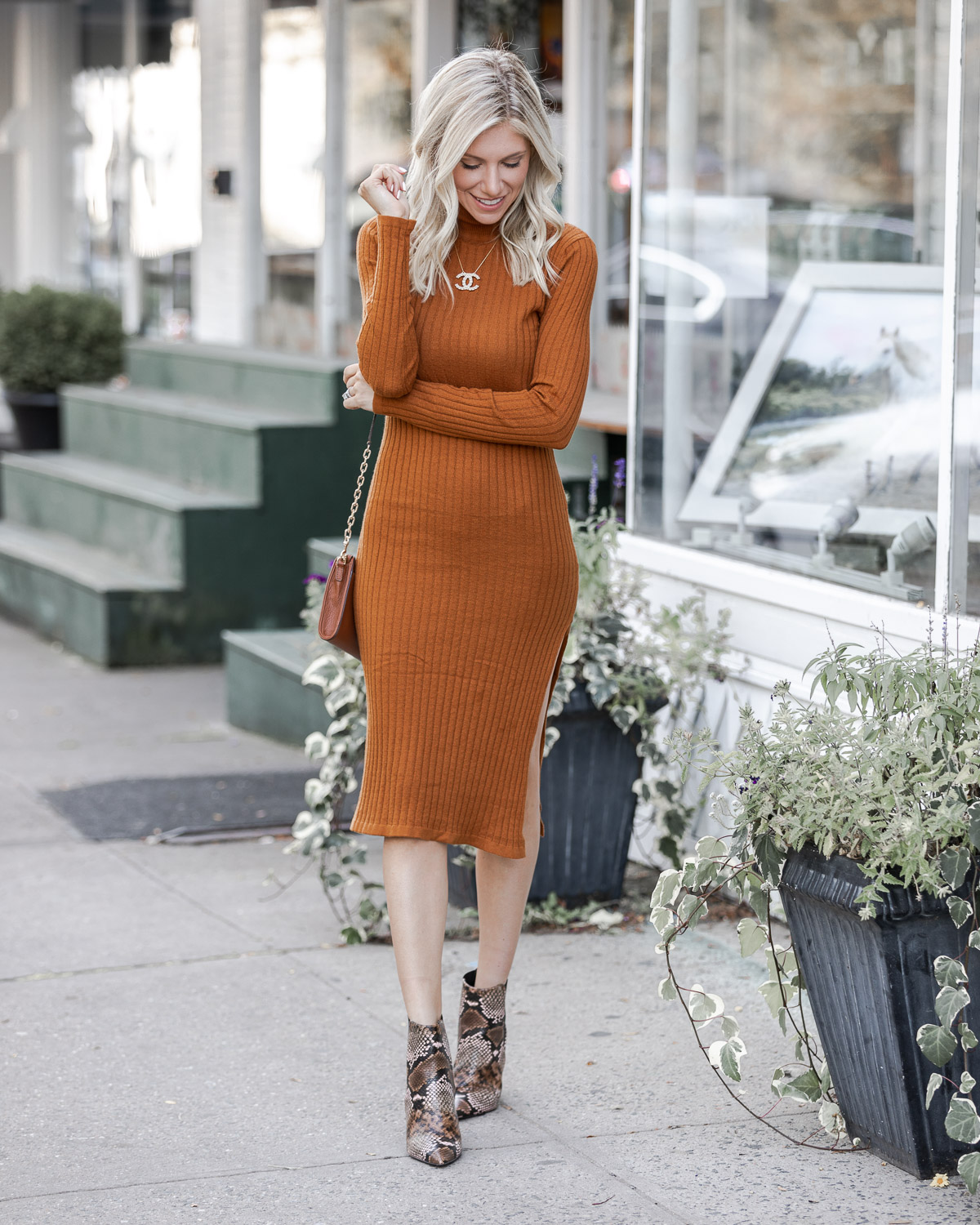 the perfect fall midi dress with snake print booties The Glamorous Gal