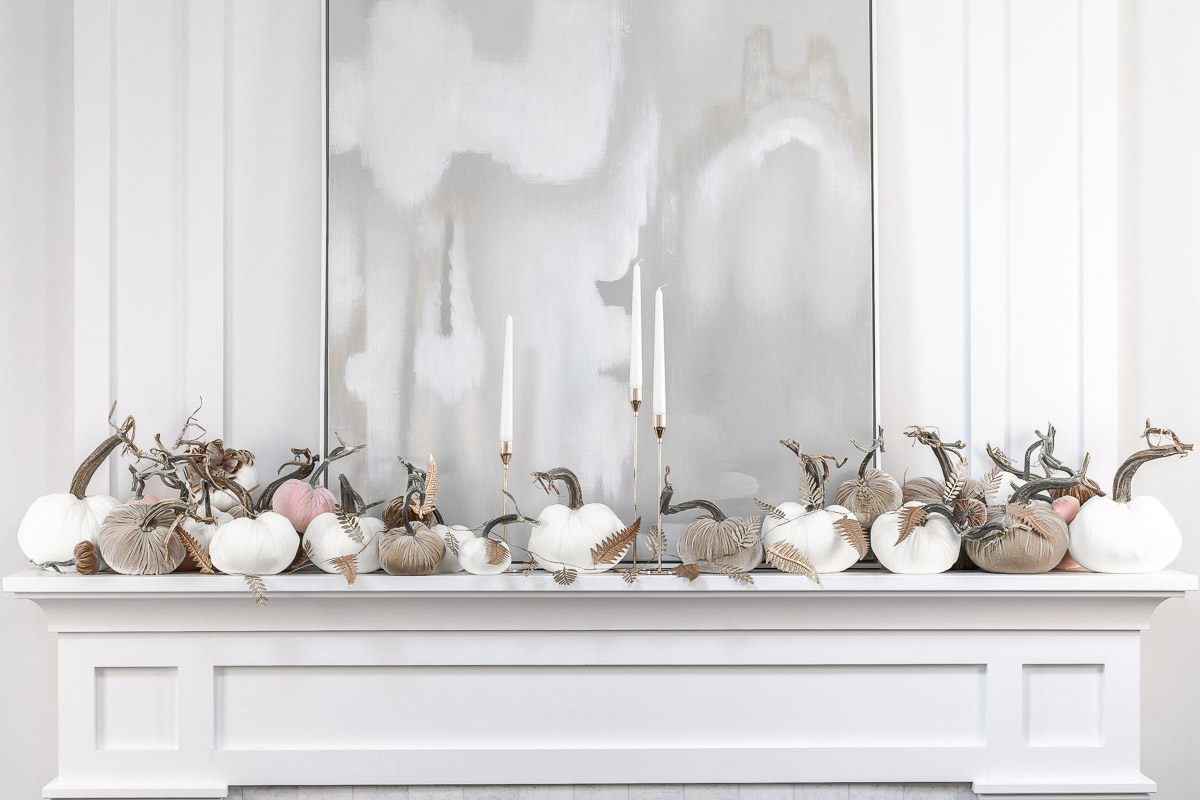 the prettiest fall home decor for the mantle with hot skwash The Glamorous Gal