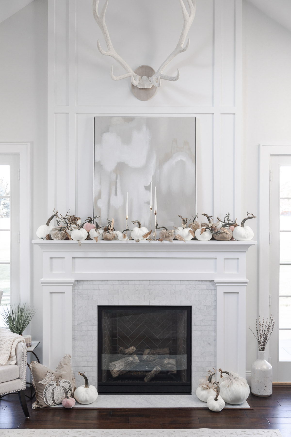 the prettiest fall mantle with hot skwash The Glamorous Gal