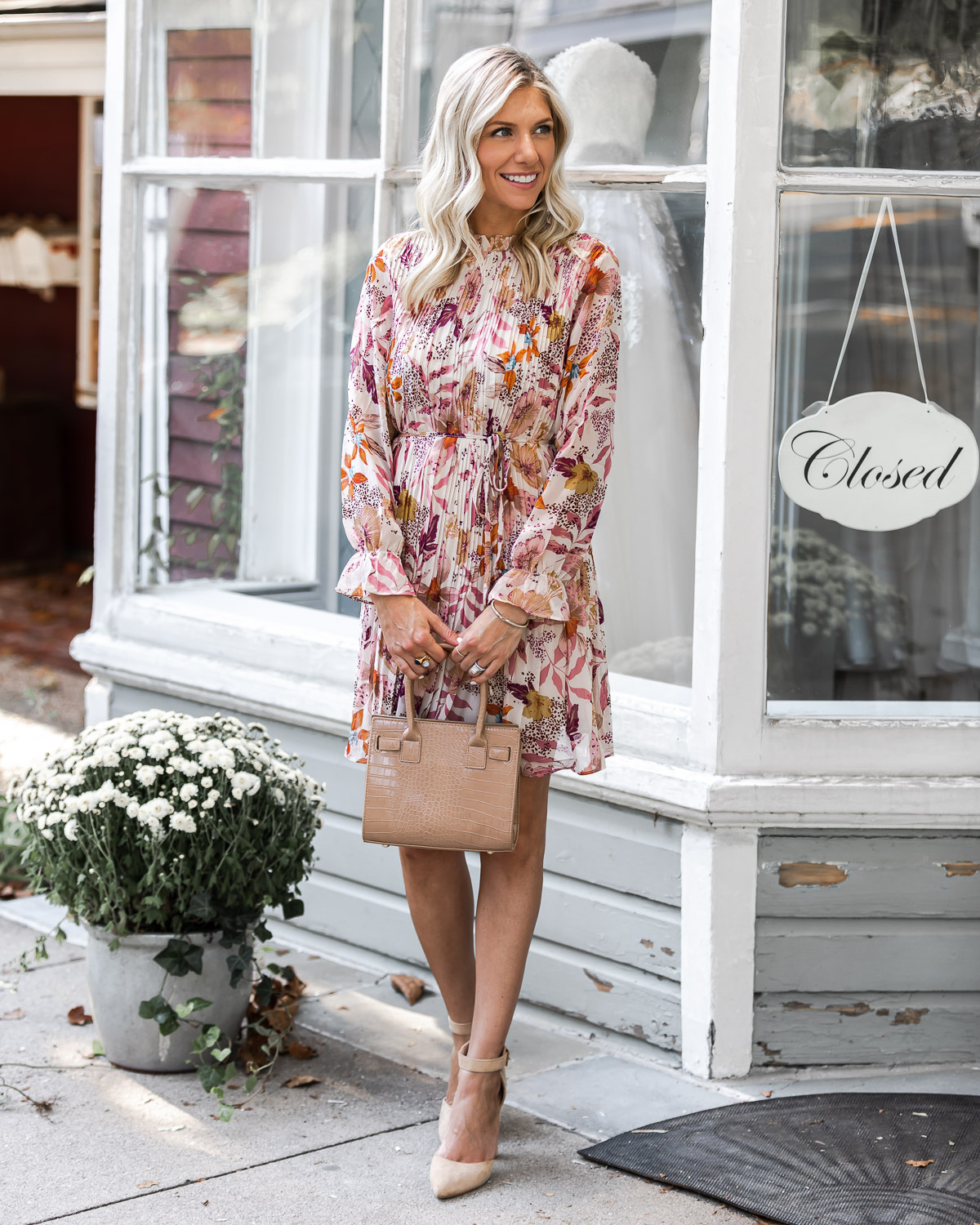floral dress and neutral accessories The Glamorous Gal