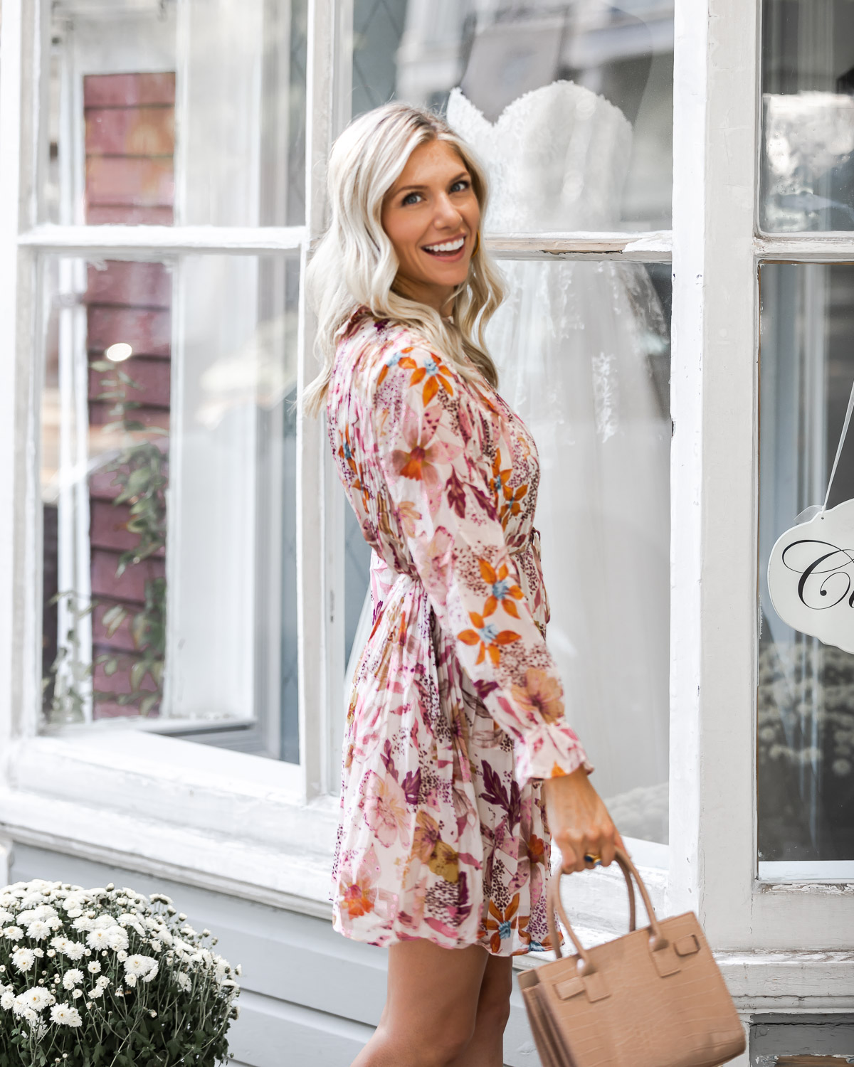 fun and flirty floral dress The Glamorous Gal