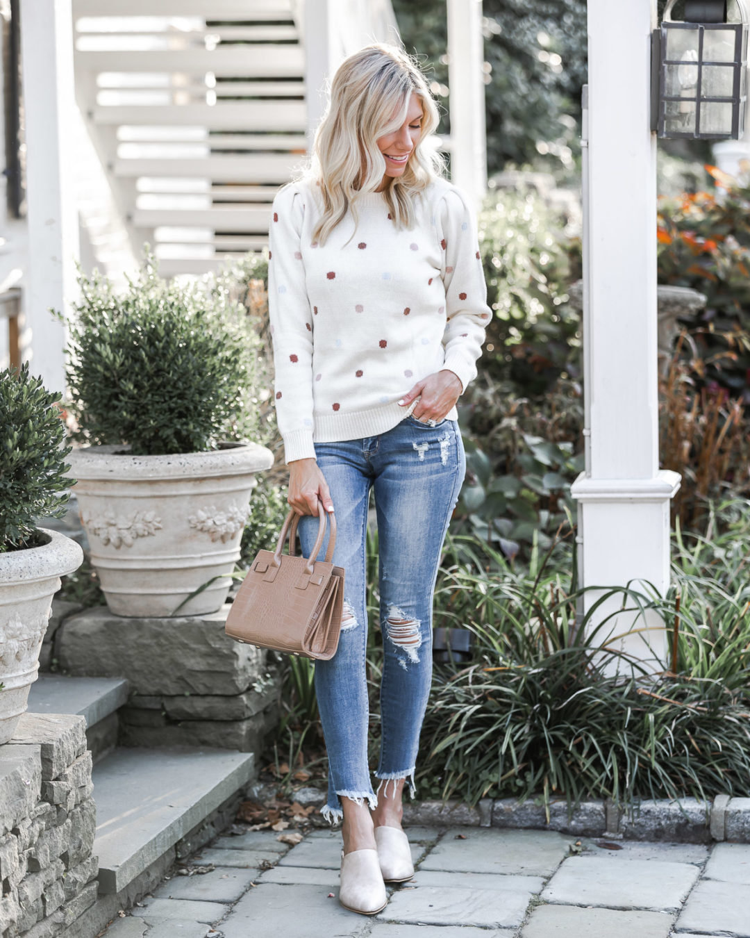polka dot sweater and tan mules The Glamorous Gal