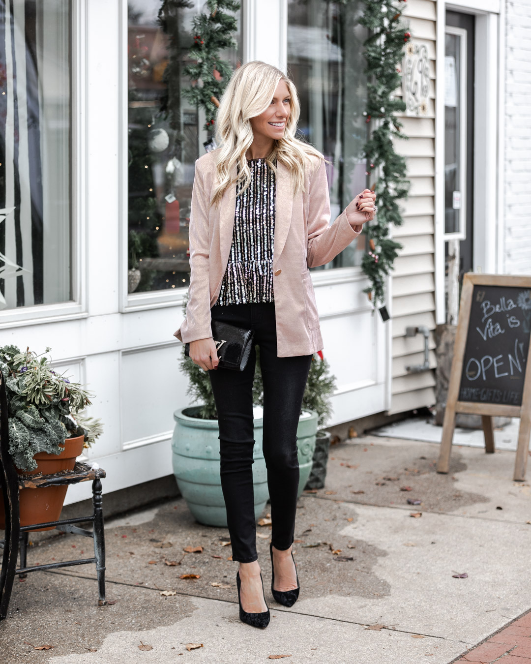 sequin top and black jeans for a casual holiday look The Glamorous Gal