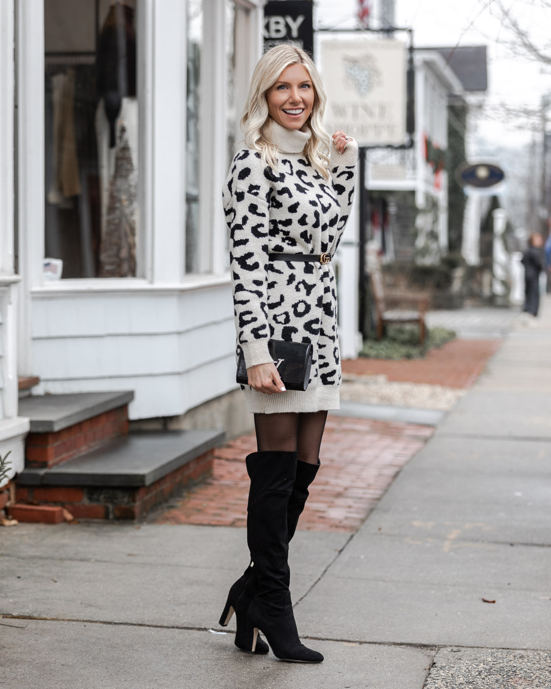 over the knee boots with sweater dress The Glamorous Gal