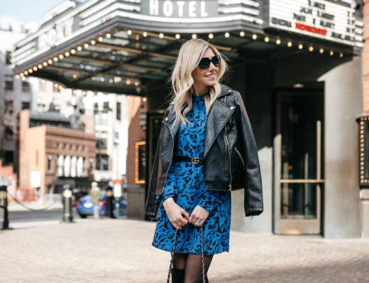 printed shift dress and leather jacket