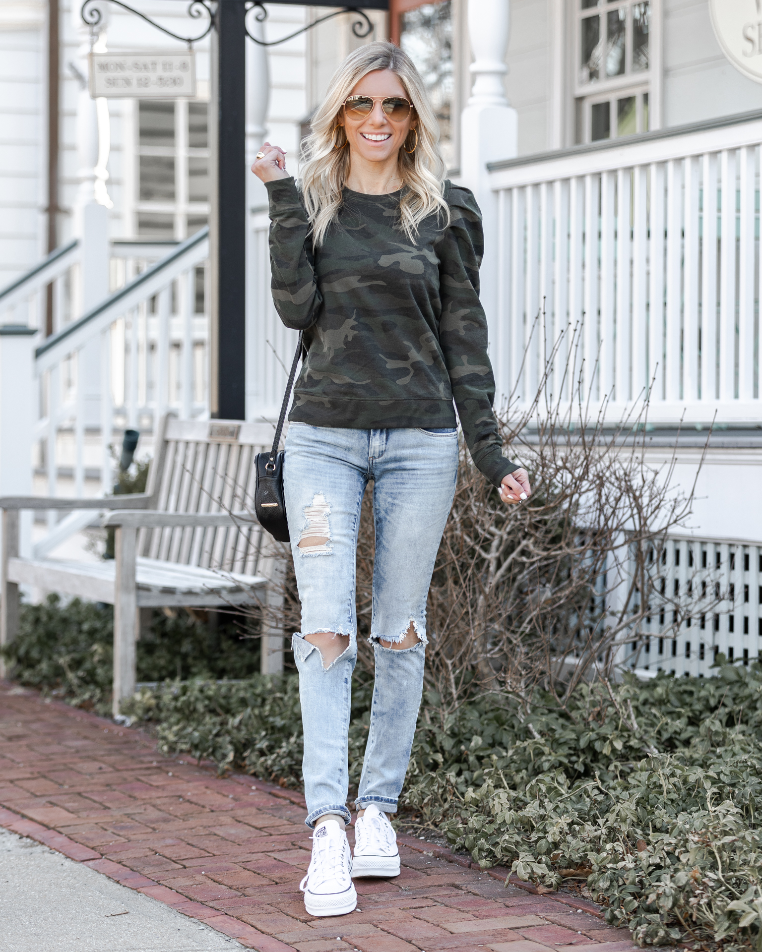 casual-ripped-jeans-and-camo-sweatshirt-the-glamorous-gal