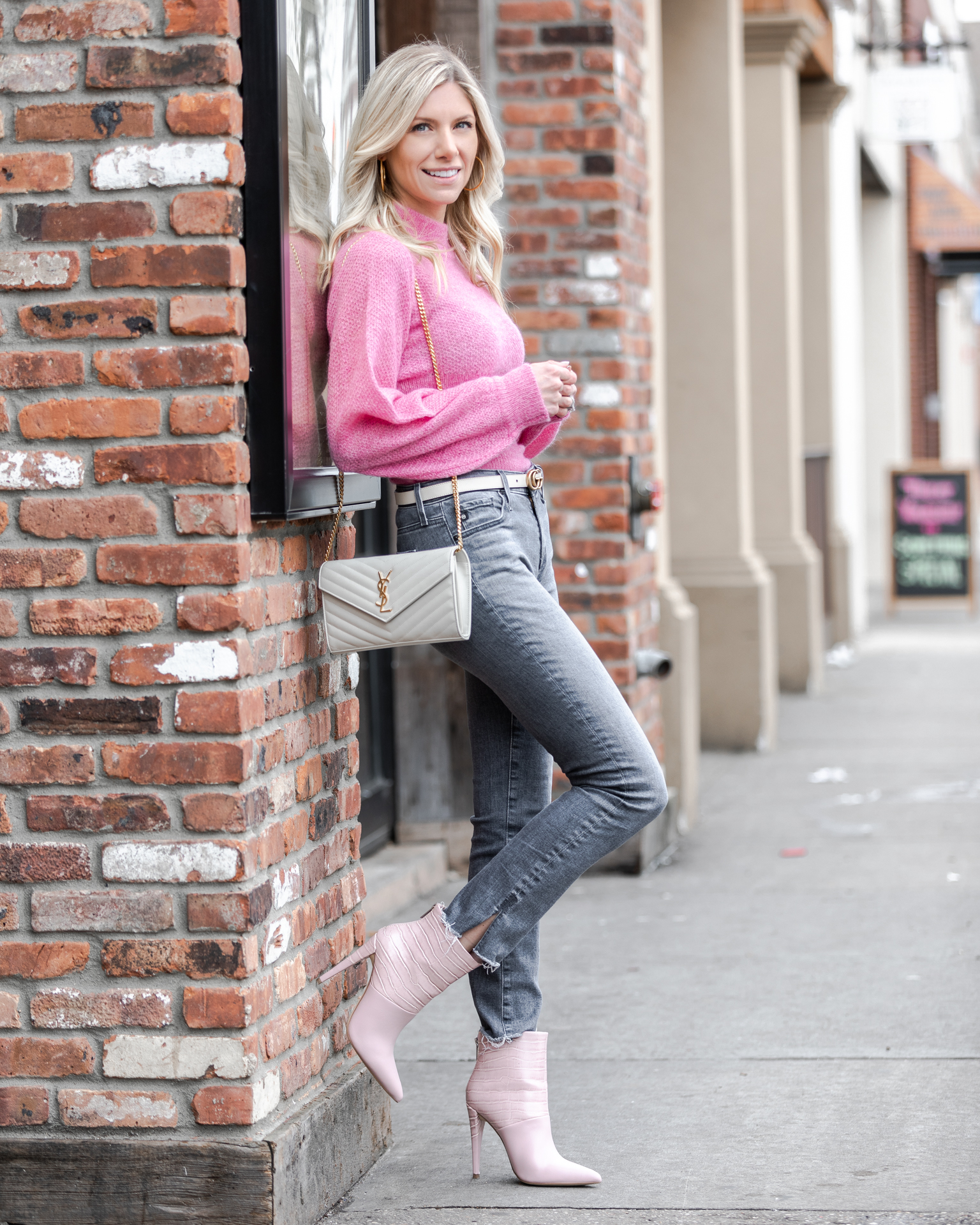pink-nicholas-sweater-and-gray-jeans