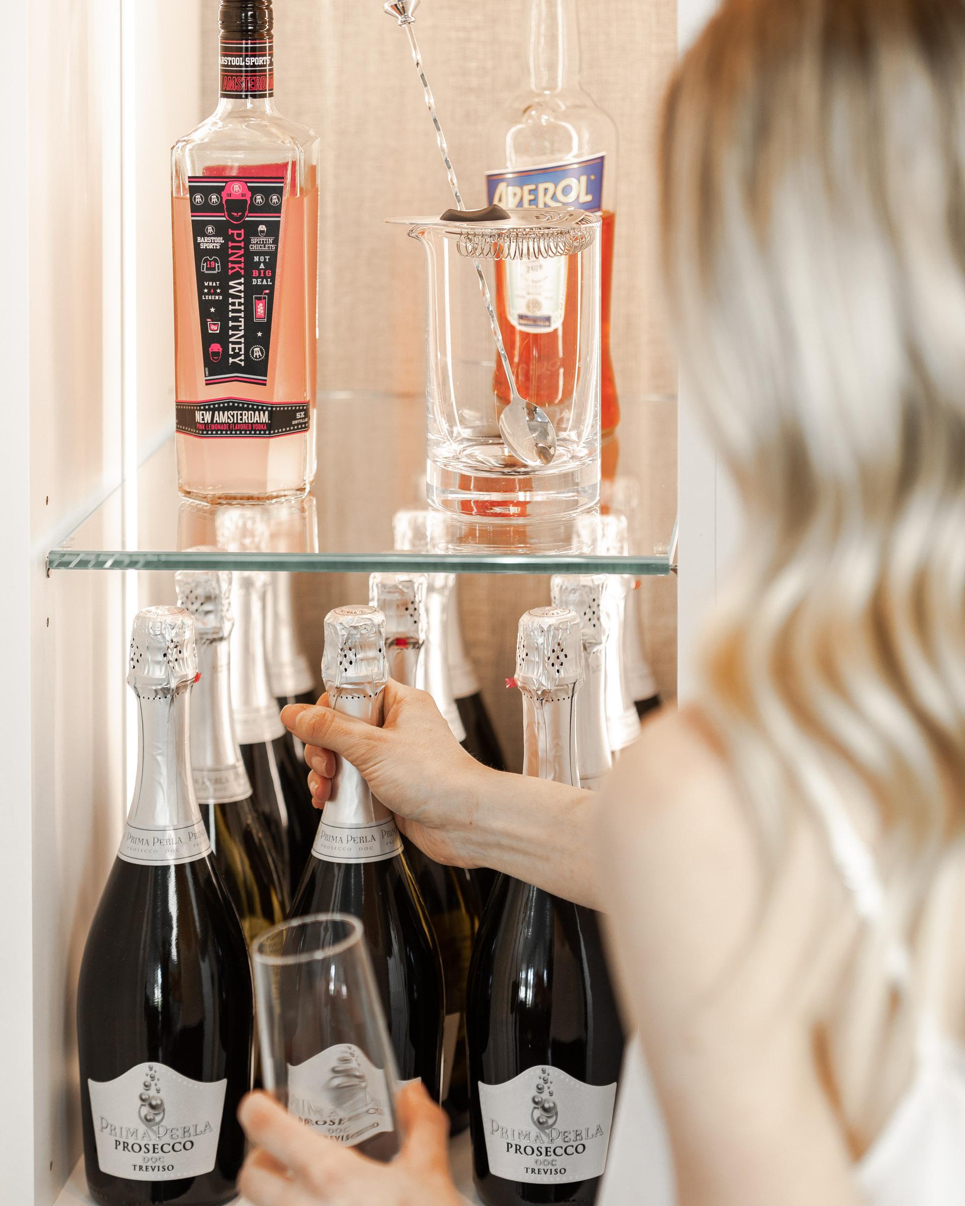 liquor-closet-aperol-spritz-the-glamorous-gal