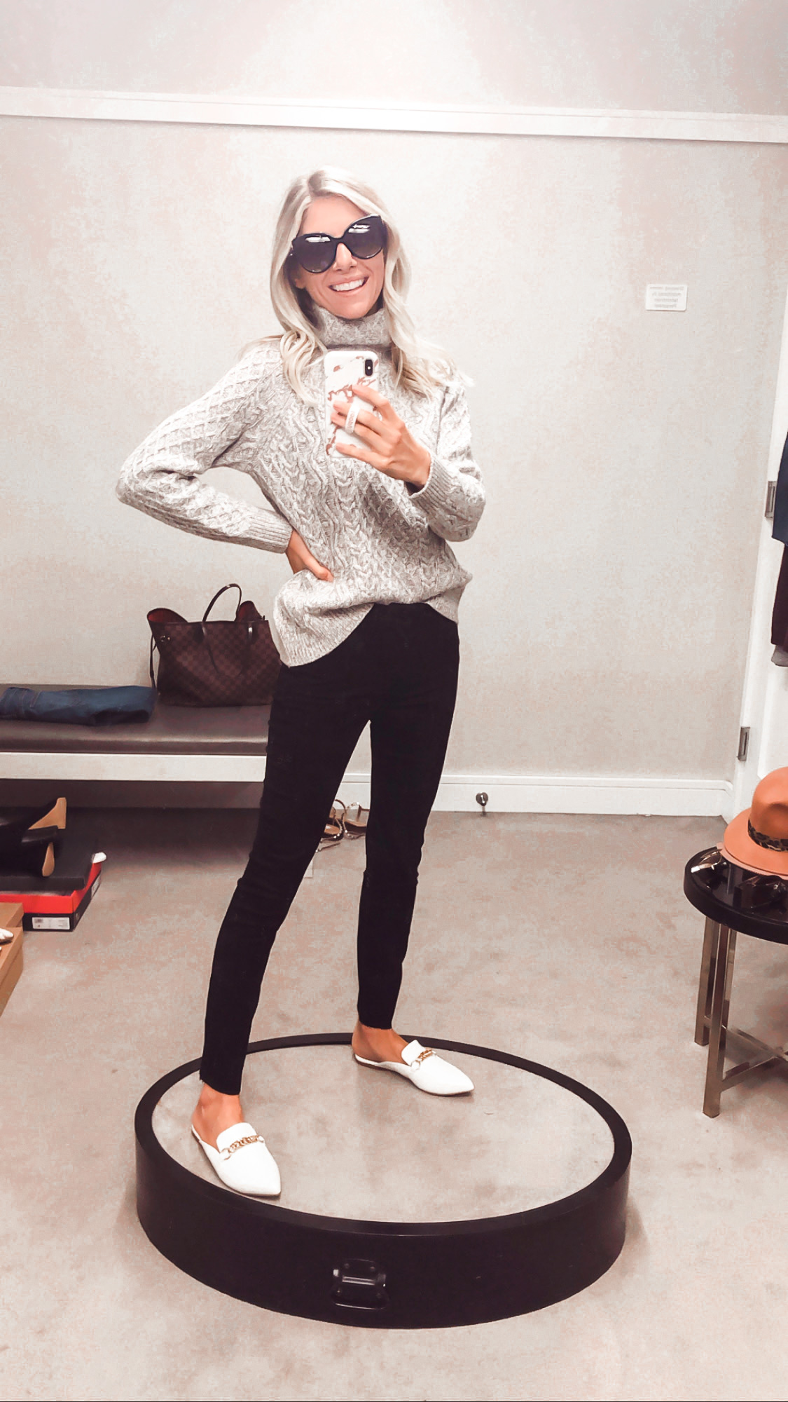 gray sweater and black jeans