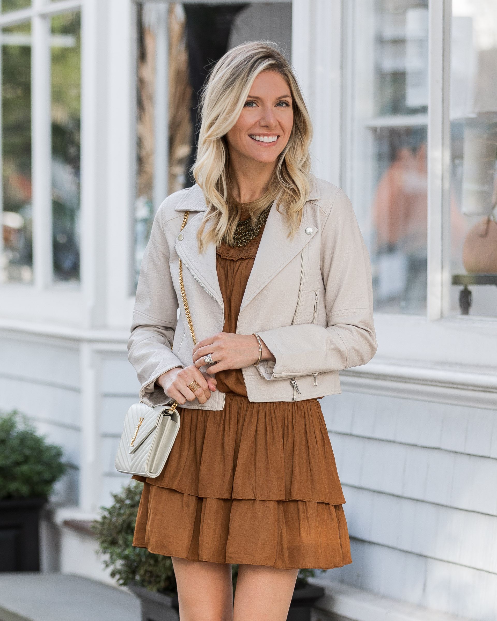 long-sleeve-rust-dress-with-white-leather-jacket-the-glamorous-gal