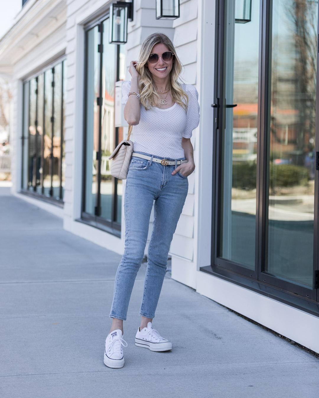 casual spring look with boyfriend jeans and bodysuit the glamorous gal
