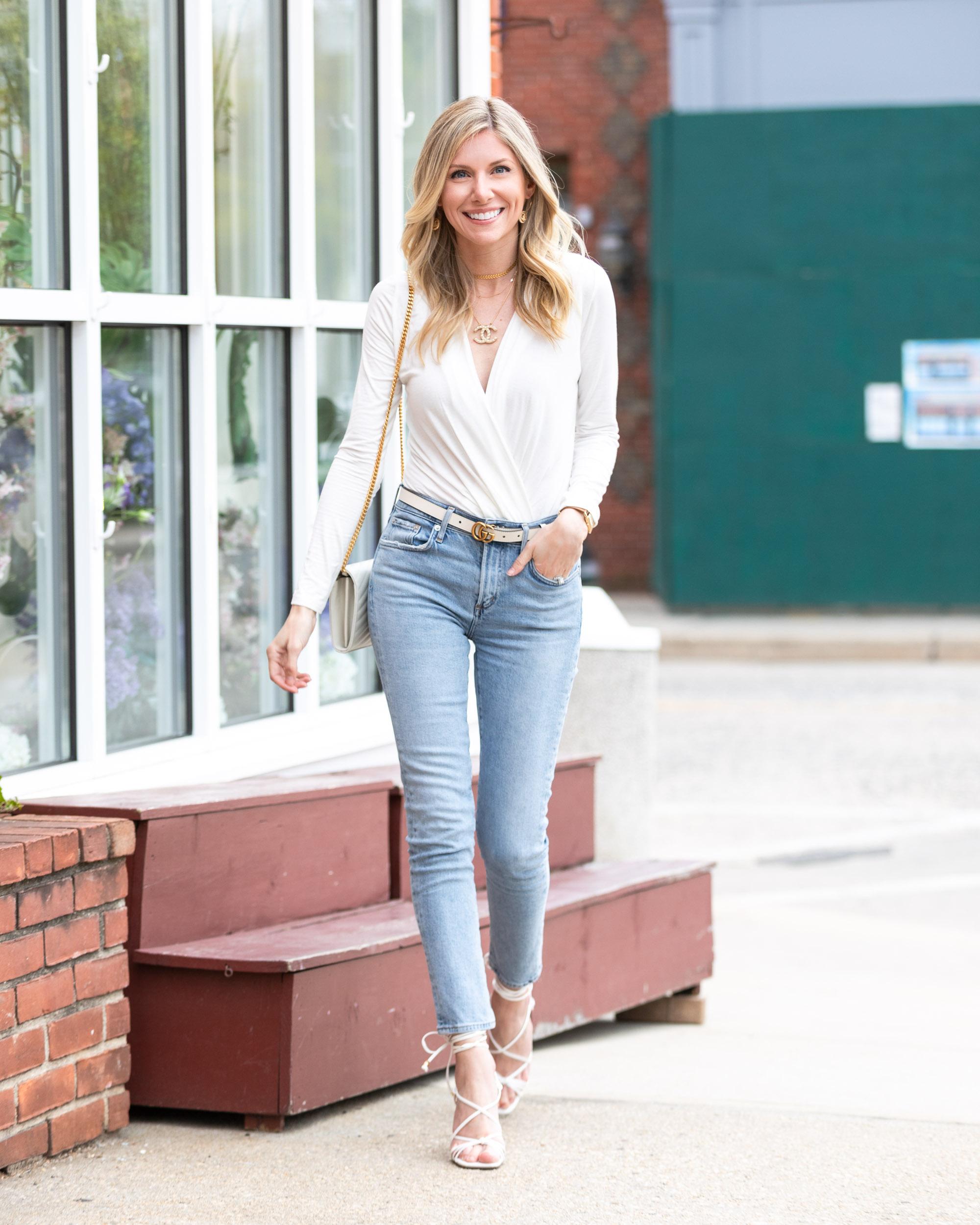 agolde-light-wash-jeans-and-white-v-neck-bodysuit-the-glamorous-gal